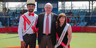 President Morgan poses with the Homecoming King and Queen.