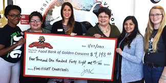 Students present check from Food Fight donations to the Food Bank of the Golden Crescent